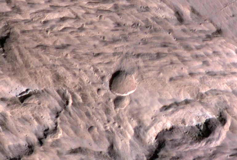 NASA orbiter discovers new Martian crater